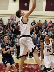 Tularosa's Dylan Hill makes a layup during the first