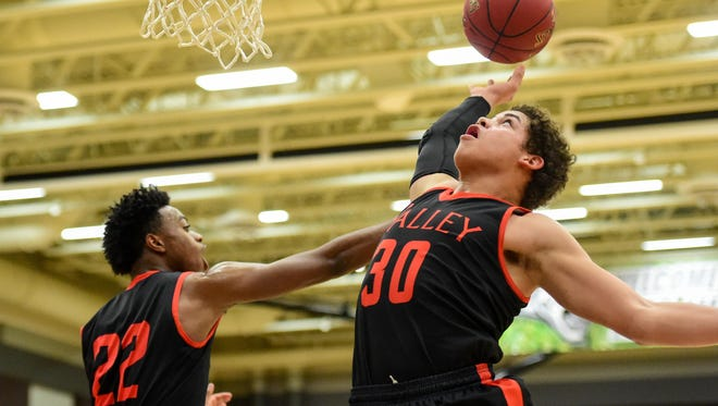 Valley's Peyton Long (30) goes up for a rebound with Carlo Marble (22) on Dec. 15 at Ankeny Centennial.