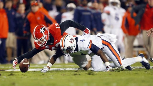 Auburn will try to end a two-game losing skid today against FCS school Samford