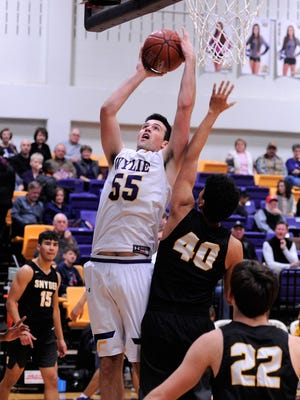 Wylie's Kyle Roberts finishes under the basket during the 76-31 win against Snyder on Friday, Jan. 12, 2018 at Bulldog Gym.