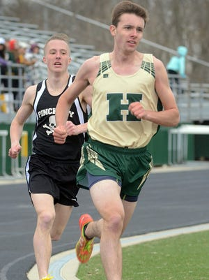 Howell's David Mitter (front) and Pinckney's Ryan Talbott are two of Livingston County's top distance runners on the track and in cross country.