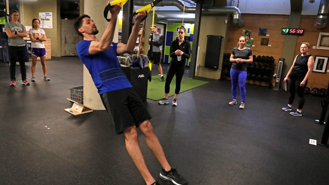 Ryan Mleziva leads at TRX suspension training class at Brew Fitness.