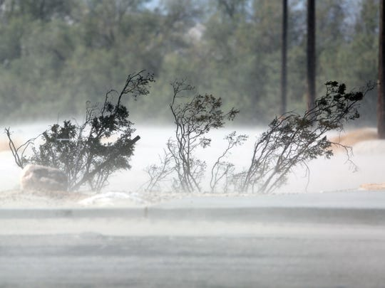 Sand and dust fill the air on a windy day in Cathedral City.