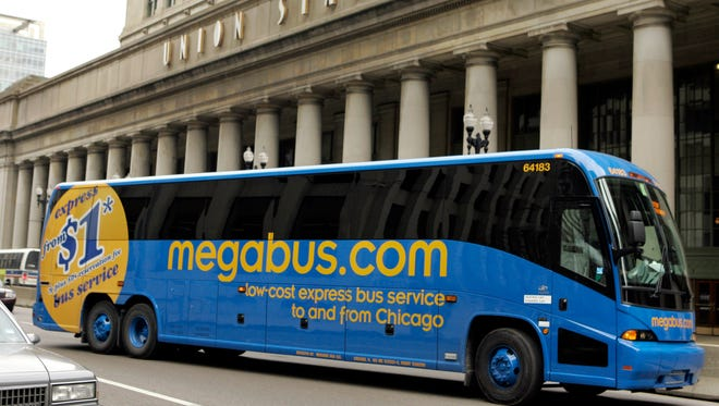 A Megabus coach pulls away from Union Station in Chicago.