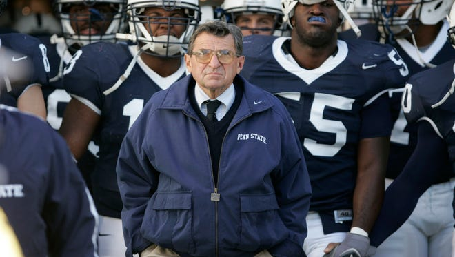 Joe Paterno's victory total stands at 409, putting him ahead of former Florida State coach Bobby Bowden, who has 377 career wins.