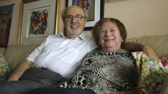 """In this Sept. 25, 2008 file photo, Herman and Roma Rosenblat pose for a photo in their North Miami Beach, Fla. home. The author and publisher of a disputed Holocaust memoir defended the book's story of love between two survivors, but also called it a work of memory and not of scholarship. """"This is my personal story as I remember it,"""" Herman Rosenblat said in a statement issued through Berkley Books, which will release his """"Angel at the Fence"""" in February."""