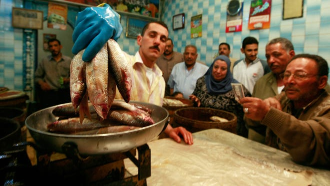 Customers buy a local delicacy known as Fesikh at a shop in Nabaroh, Egypt on April 26, 2008.
