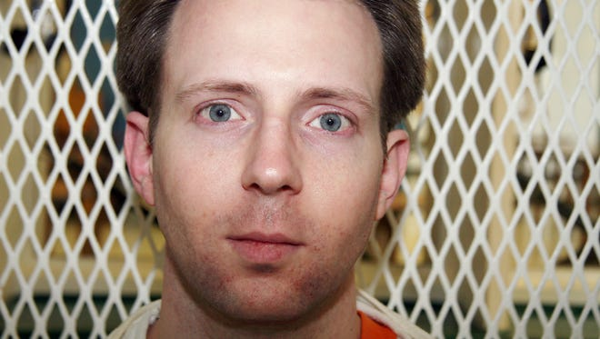 Convicted killer Adam Kelly Ward is photographed Feb. 10, 2016, in a visiting cage outside death row at the Texas Department of Criminal Justice Polunsky Unit near Livingston, Texas.