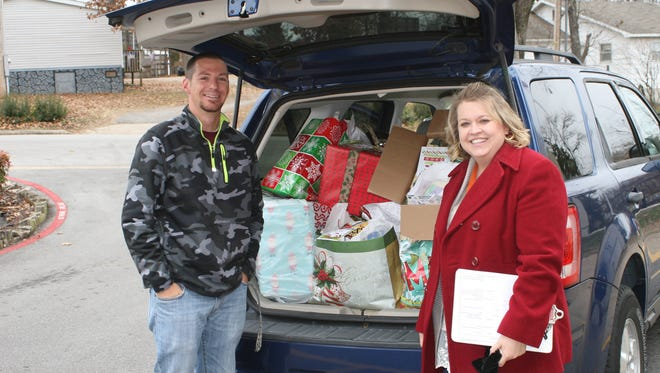 Myranda Zimmerebner, general manager of Branson Mill, shows one car load full of gifts for the adopted seniors.