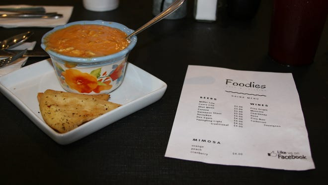 Foodies Cafe and Catering features a popular half sandwich, half salad or soup combo daily, along with other daily specials. Featured is their chicken tortilla soup with pita chips and a list of their beer and wine menu.