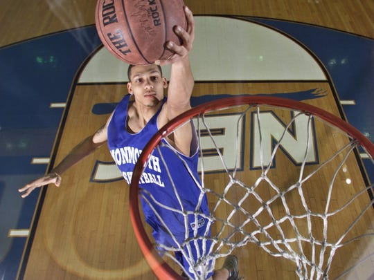 Gerry Crosby, Monmouth Basketball player, practicing his shot in this file photo