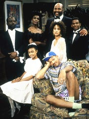"Joe Marcell, left, Janet Hubert (the original Aunt Viv), James Avery, Karyn Parsons, Alfonso Ribeiro, Tatyana Ali, and Will Smith on ""The Fresh Prince of Bel-Air."""