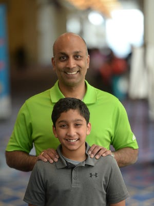 Atman Balakrishnan, 12, and his father Dr. Balu Natarajan from outside Chicago. Atman is competing in the 2018 Scripps National Spelling Bee at the Gaylord National Resort and Convention Center. Natarajan won the bee in 1985.