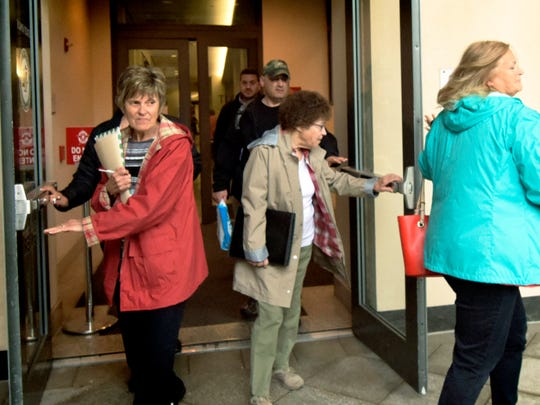 Citizens Against Transource Energy members leave a hearing at the York County Judicial Center Wednesday, April 25, 2018. Bill Kalina photo