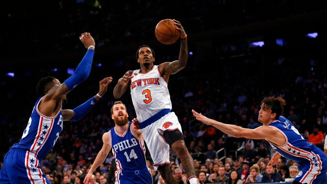 New York Knicks guard Brandon Jennings (3) drives to the basket against Philadelphia 76ers forward Robert Covington (33),  guard Sergio Rodriguez (14) and  forward Dario Saric (9) during a game earlier this season.