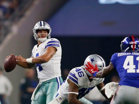 Dallas Cowboys quarterback Dak Prescott (4) throws a pass in the second quarter against the New York Giants  at AT&T Stadium.