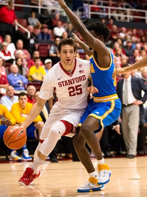 Stanford Cardinal forward Rosco Allen (25) dribbles the ball around UCLA Bruins guard Isaac Hamilton (10) in the first half at Maples Pavilion.