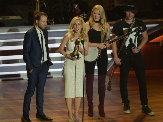 Kim Campbell and their children accept the Career Achievement