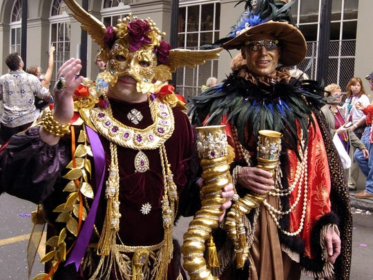 Mardi Gras revelers dressed in costume and made their