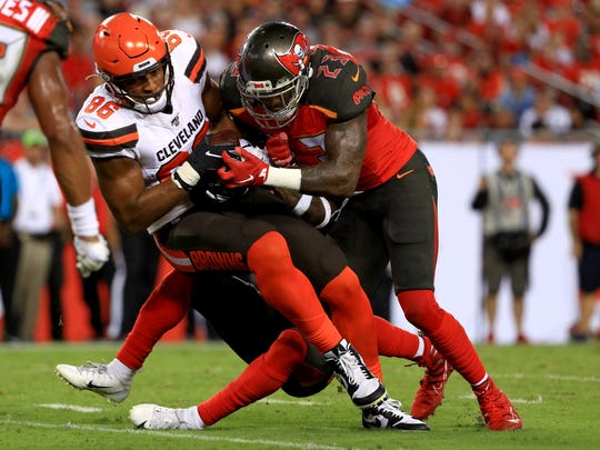 TAMPA, FLORIDA - AUGUST 23: Pharaoh Brown #86 of the Cleveland Browns makes a catch against Deone Bucannon #23 of the Tampa Bay Buccaneers during a preseason game  at Raymond James Stadium on August 23, 2019 in Tampa, Florida. (Photo by Mike Ehrmann/Getty Images)