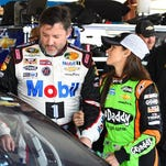 Danica Patrick, right, and Tony Stewart share a moment in the garage at Chicagoland Speedway on Sept. 13.