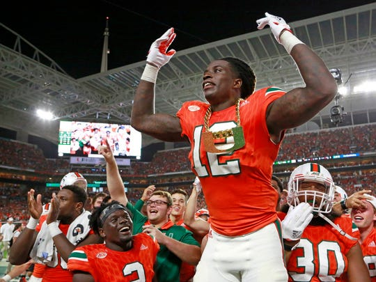 Miami defensive back Malek Young wears the turnover chain after an interception in the second quarter against Notre Dame in November at Hard Rock Stadium in Miami Gardens, Fla.