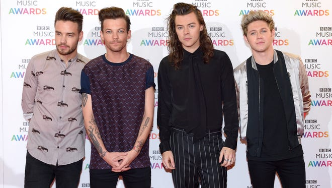 Liam Payne, Louis Tomlinson, Harry Styles and Niall Horan of One Direction on Dec.10, 2015, in Birmingham, England.