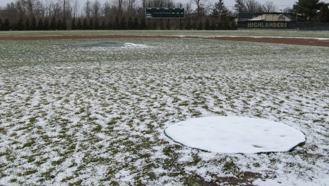 A dusting of snow covers portions of the Howell baseball field on Tuesday, April 17, 2018.