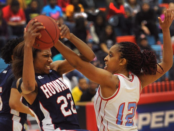 Lady Hornet Deanna Harmon trys to steal ball away from Howard's Victoria Gonzalez in 1st half of game Saturday in Dover.