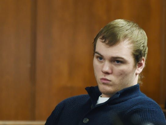 In this Wednesday, March 21, 2018, photo, Anthony Gelia appears for his open murder trial in front of Jackson County Circuit Court Judge John McBain in Jackson, Mich. Gelia is accused of breaking into a home and shooting a woman while streaming on Facebook Live. (J. Scott Park /Jackson Citizen Patriot via AP)