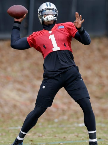 Panthers QB Cam Newton throws a pass in practice Thursday.
