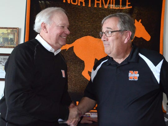 Kurt Kinde, right, is pictured with fellow Northville High School teacher Douglas Dent.