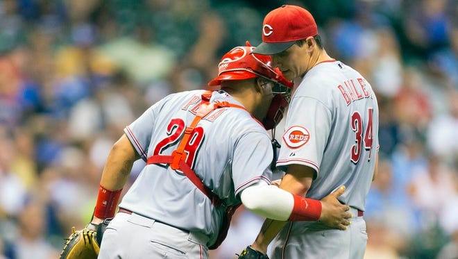 Cincinnati Reds catcher Brayan Pena (29) talks with pitcher Homer Bailey (34) during the fifth inning against the Milwaukee Brewers at Miller Park.
