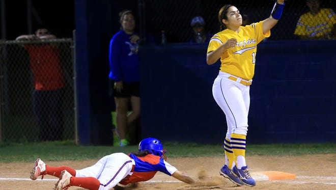 Moody's Iliana Elizondo reaches for the ball as Gregory-Portland's Destiny Escamilla slides back to first base on Tuesday, April 18, 2017, at Gregory-Portland High School in Portland.