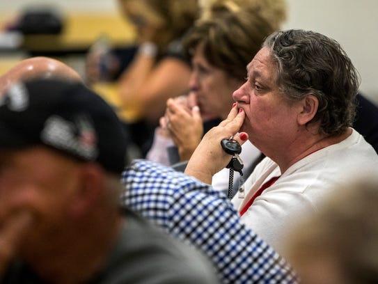 Ann Nunley listens during a school board special meeting
