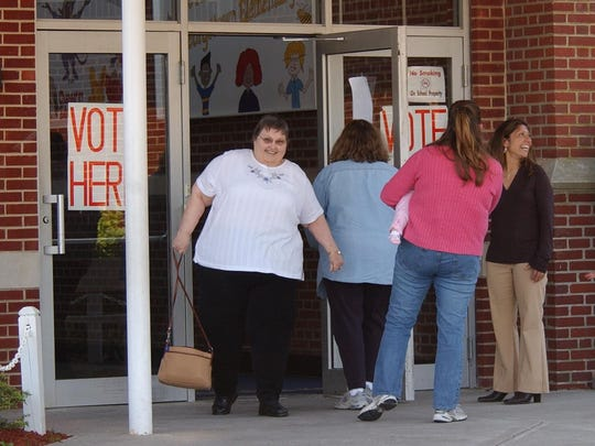 A voter leaves Georgetown Elementary school after casting her ballot in an Indian River school board election Tuesday in 2006.