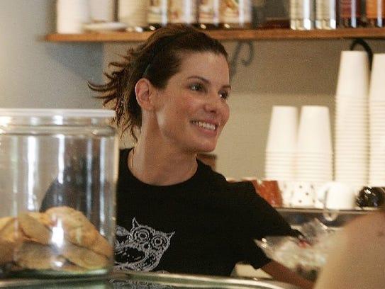 Actress Sandra Bullock serves customers pastries at