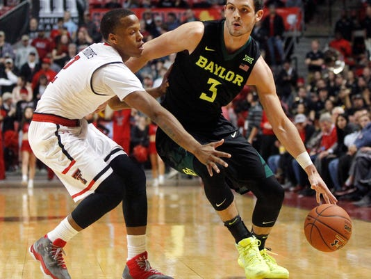 Baylor guard Jake Lindsey drives around Texas Tech guard Devon Thomas during the first period of an NCAA college basketball game Monday, Feb. 13, 2017, in Lubbock, Texas. (AP Photo/Mark Rogers)