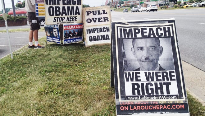 Protesters in Waynesboro on Friday, July 18, 2014, want to impeach Obama, and liken him to Adolf Hitler.