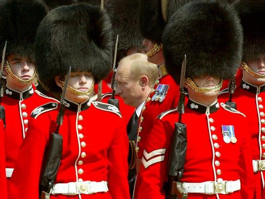 Russian President Vladimir Putin inspects the guards