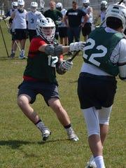Pennfield senior Cody Sackett plays defense during