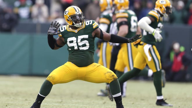 Green Bay Packers Datone Jones (95) celebrates his tip of a Cowboys field goal against the Dallas Cowboys during an NFC divisional playoff  Sunday, January 11, 2015, at Lambeau Field in Green Bay, Wis.  Wm.Glasheen/P-C Media