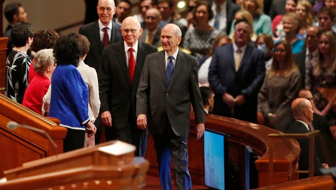 LDS Church President Russell M. Nelson, right, as his counselors Dallin H. Oaks, center and Henry B. Eyring, left, are shown during the start of a twice-annual conference of The Church of Jesus Christ of Latter-day Saints Saturday, March 31, 2018, in Salt Lake City.