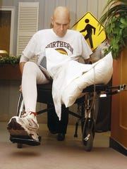 Coach Don Meyer tries to negotiate a ramp during rehab after a life-threatening car crash and cancer diagnosi in 2008.