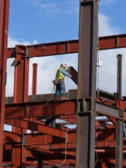 Workers construct the William N. Pennington Student Achievement Center on the UNR campus on Jan. 12, 2015.