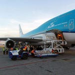 A handout picture provided by the Mexican Secretariat of Foreign Affairs (SRE) shows the bodies of eight Mexican tourists killed in Egypt being unloaded from a KLM airline aircraft, in Mexico City, Mexico, 22 September 2015.