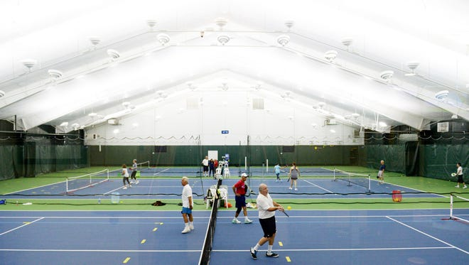 Pickleball players at the Tenafly Racquet Club. The fast-paced sport, which combines elements of tennis, badminton and ping-pong, is building a following across the region, particularly among older players.
