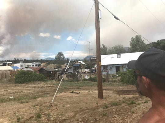 Carl Wilson, 53, refused to evacuate his Hornbrook home. On Friday, he looks at the smoke growing on the other side of Interstate 5.