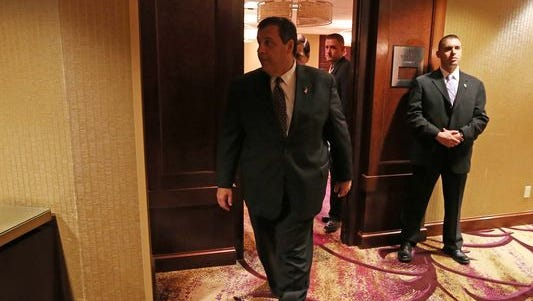 New Jersey Gov. Chris Christie makes his way to a ballroom to speak at the Dallas County GOP Spring Speaker Series on Monday in West Des Moines.
