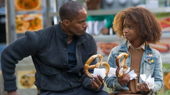 Jamie Foxx, left, as Will Stacks and Quvenzhane Wallis as Annie in 'Annie.'